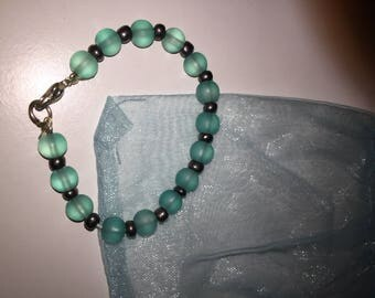 Children's blue glass bead and silver bracelet