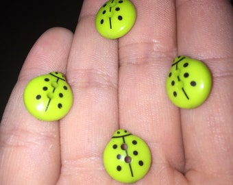 Lime green ladybird buttons in set of 9