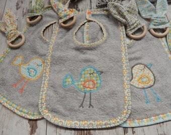 Scandinavian fabric bird motif bib