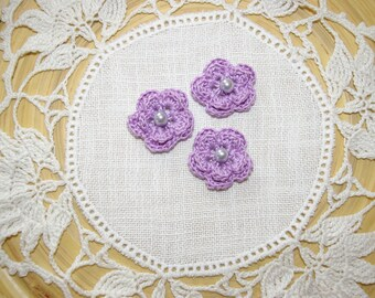 small purple flowers with Czech glass pearls to crochet for scrapbooking embellishment