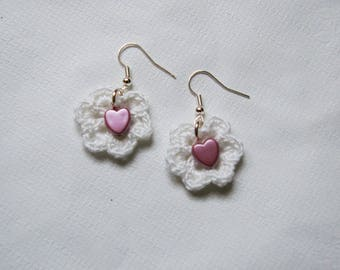 pair of white and pink crochet earrings