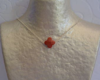 Brick red clover necklace and silver chain.