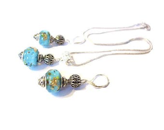 Beautifully set, 925 sterling silver, speckled blue European beads