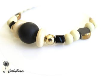 elegant bracelet made of bronze, stone and wood beads