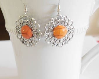 Orange and silver dangling earrings