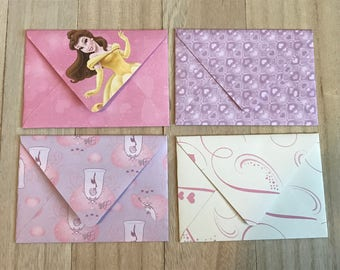 Four princess theme lined envelopes with notecards