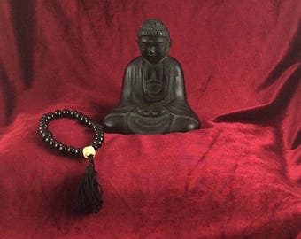 Buddhist-style mala with bone skull bead