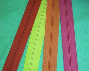 Set of 4 closures zipper 25 cm assorted bright colors pink, red, yellow and orange