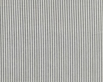 Oilcloth has a grey Pinstripe on ecru white vertical