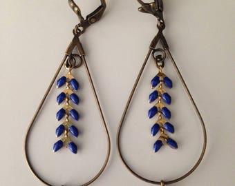 Fancy dark blue spike earrings