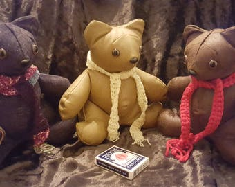 Hand-made suede or faux leather teddy bear