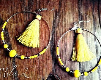 Tassel and yellow beaded hoop earrings