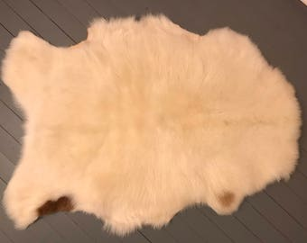 Sheepskin - Mostly white with brown spots