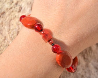 Red beaded bracelet with coral