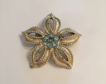 Vintage flower brooch with blue rhinestones