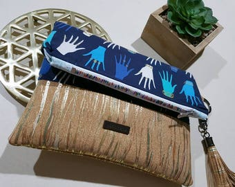 Beautiful handmade glove print foldable clutch. Made with high quality quilting materials. Could carry purse and iPhone in it.