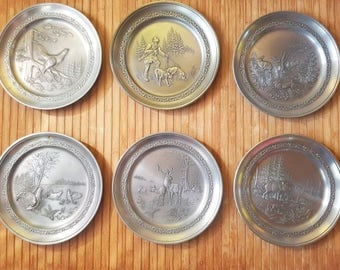 A Collection Set of Six Original Vintage German Pewter Wall Plates, Hunter Wood Nature Theme, 95% Zinn, HTM Pewter, Handmade, Angel Mark