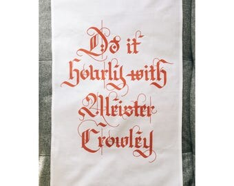 Aleister Crowley Tea Towel for satanic dishes. Handwritten gothic lettering printed onto a cotton tea towel