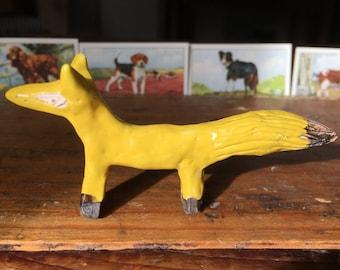 Lemon yellow ceramic fox