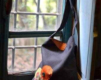 Grey bag with orange decoration