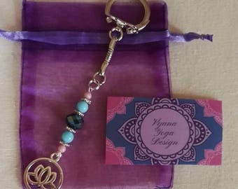 Unique handmade key chain with silverdetails, lotus symbol and colourful beads
