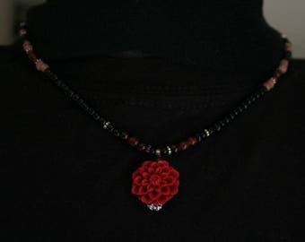 Black and garnet beaded necklace with red flower pendant