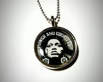 Power and Equality pendant with 24 inch ball chain.