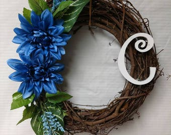 Grapevine wreath with the Letter C and blue flowers.
