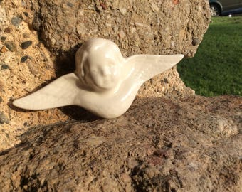 White ceramic wall-mounted angel
