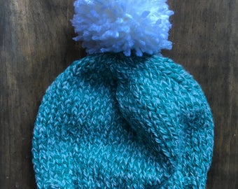Teal and white variegated Pom Pom winter hat, 6-9 months