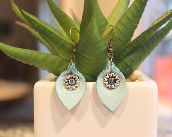 small, teal, re-purposed genuine leather leaf shaped earrings with flower charm
