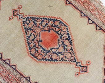 Small worn antique rug