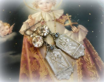 be my guide one of a kind vintage assemblage earrings vintage rhinestone buttons swarovski bead balls very vintage st. christopher medals