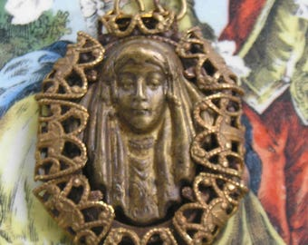 A very sweet and rather petite Gypsy Queen pendant in vintage brass..