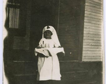 Vintage photo 1918 Little Girl REd Cross Nurse Abstract Black and White trim RPPC