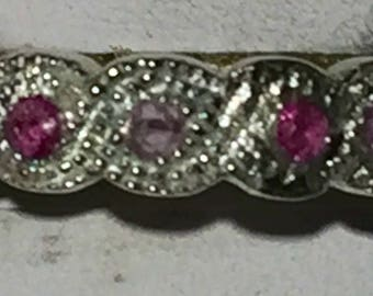 Pink sapphires in silver band size 6.75