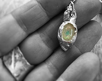 woke pendant in fine silver with exquisite welo opal