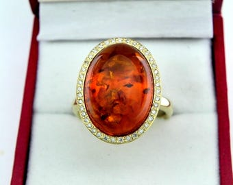 AAAA Amber 18 x 13mm  5.43 Carats   14K Yellow gold Diamond halo cabochon ring. 1525