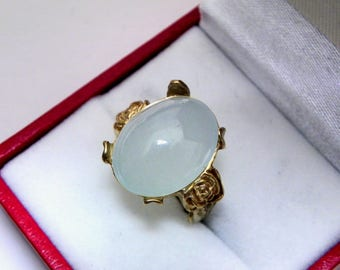 AAA Aquamarine Cabochon 8.52 carats 14.4x11.3mm set in an old Antique style Floral 14K yellow gold ring. 1171