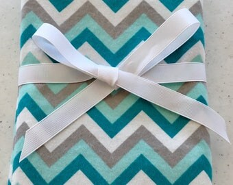 Teal, gray and white flannel swaddler
