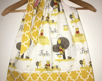 Winnie the Pooh, Pooh dress,  available in size 3,6,9,12,18, months ,2t,3t,4t,5t,6,7,8,10,12