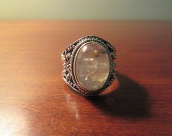 Beautiful .925 sterling silver ring with oval moonstone- size 8.25- very nice condition