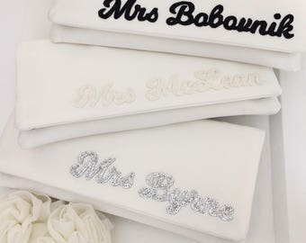 Ivory personalised MRS surname satin wedding day bridal clutch purse