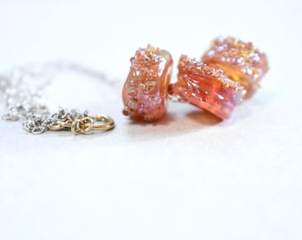 artisan glass bead necklace. handmade glass beads on a chain. artisan bead trio necklace. artisan bead jewelry. minimalist bead necklace
