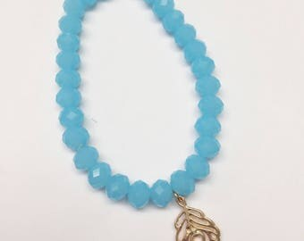 Aqua Blue 5mm Faceted Crystal Bead Bracelet with Gold Peacock Feather Charm