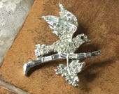 Beautiful Sparkling Clear Pave Rhinestone Bird Leaf Brooch Pin Unsigned Silver Tone Rhodium Plated 1970's 1980's Flying Wings Perched Branch