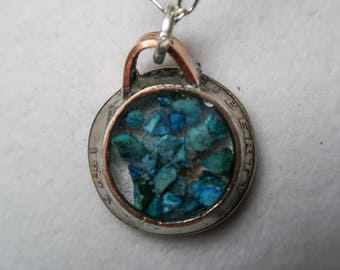 Turquoise shards set in hand hammered 1995 US quarter pendant featuring Oklahoma red dirt