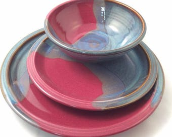 3 piece stoneware dinnerware set twilight blue raspberry red pottery dinnerware set ceramic stoneware
