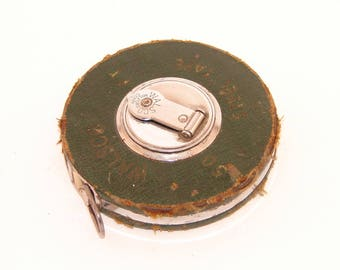 vintage walsco 50 foot steel tape measure in leather covered metal roll up case