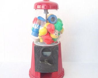 SALE Vintage red gumball machine filled with Fisher Price Little People.  Toys.